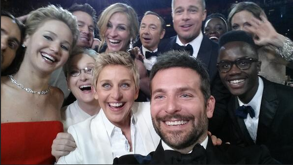 Photo of Ellen Degeneres and multiple celebrities taken while at the Oscars broadcast